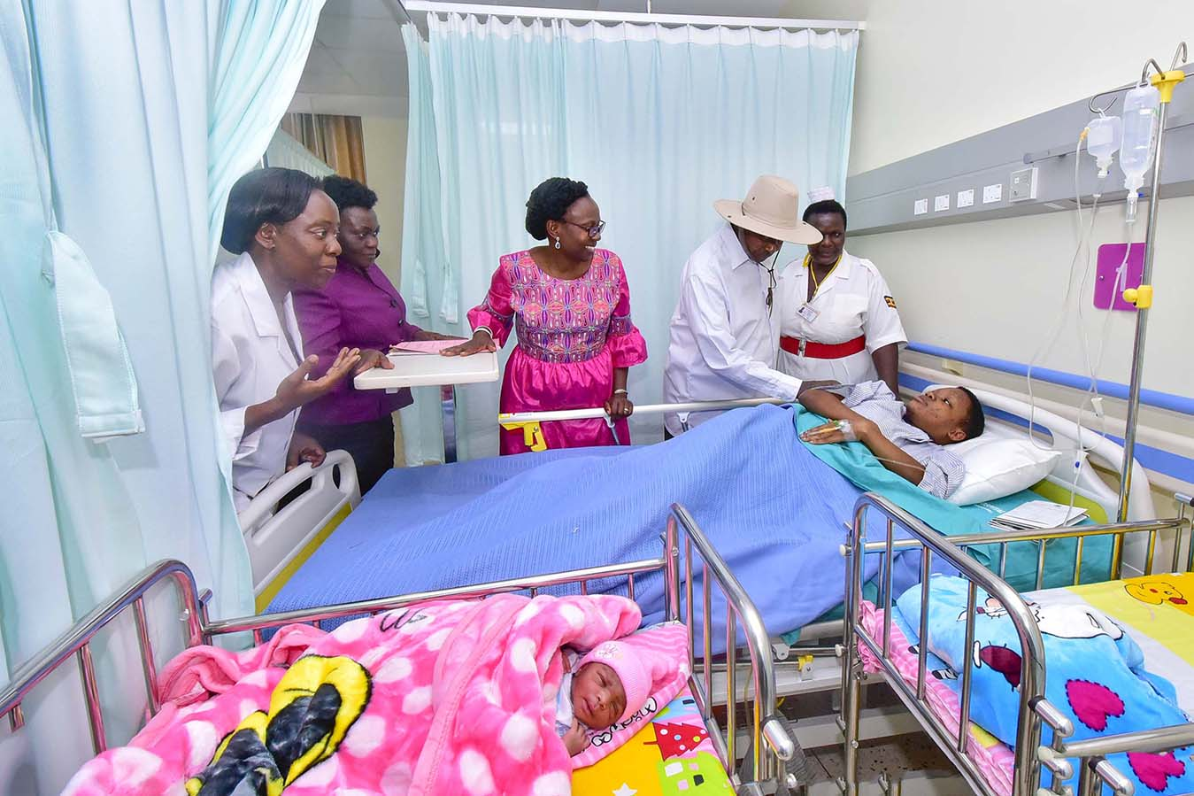 President Yoweri Kaguta Museveni together with health Ministers Ruth Acheng and Sarah Opendi among other health officials and hospital staff interacting with one of the new mothers , Angella Nalukenge while inspecting some of the facilities of the New Mul